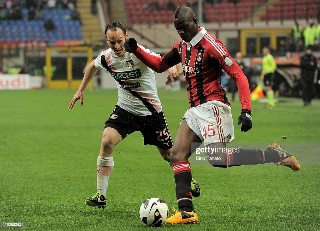 Mario Balotelli (R) of AC Milan competes with Steve Von Bergen of US Citta di Palermo during the Serie A match between AC Milan and US Citta di Palermo at San Siro Stadium on March 17, 2013 in Milan, Italy.