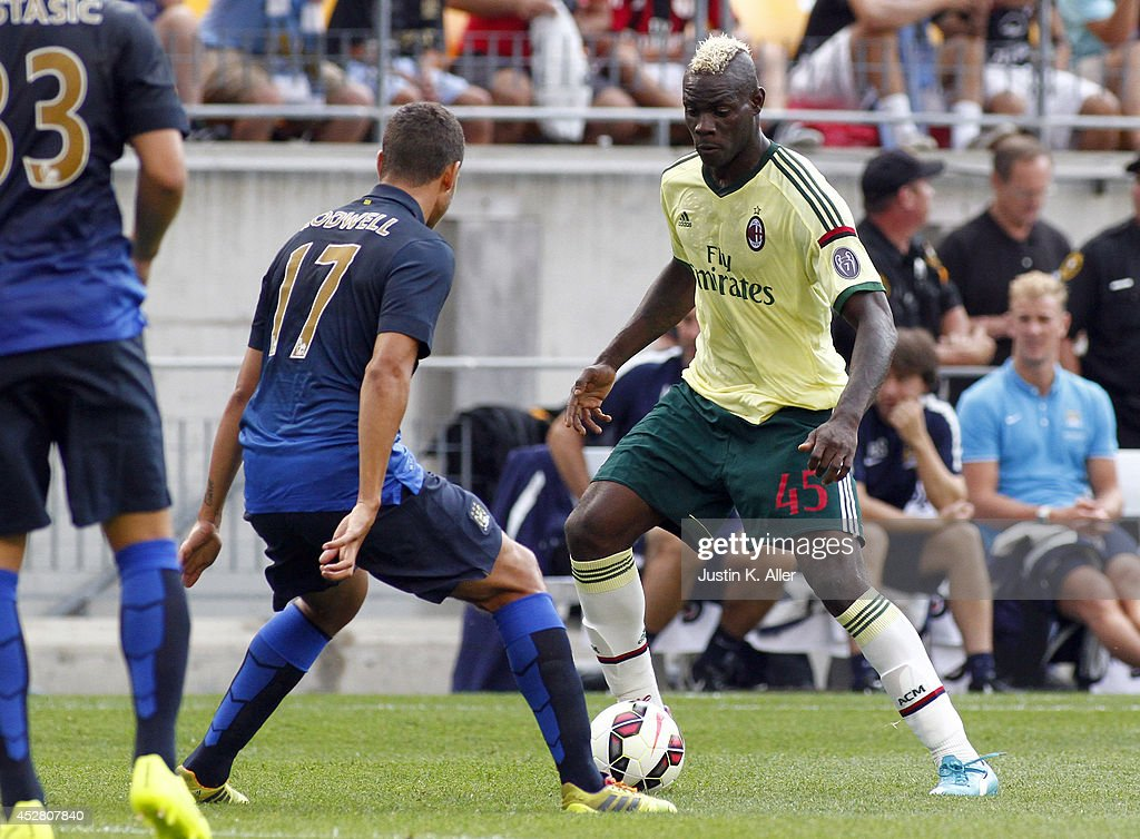 <a gi-track='captionPersonalityLinkClicked' href=/galleries/search?phrase=Mario+Balotelli&family=editorial&specificpeople=4940446 ng-click='$event.stopPropagation()'>Mario Balotelli</a> #45 of AC Milan handles the ball against <a gi-track='captionPersonalityLinkClicked' href=/galleries/search?phrase=Jack+Rodwell&family=editorial&specificpeople=4266551 ng-click='$event.stopPropagation()'>Jack Rodwell</a> #17 of Manchester City during International Champions Cup 2014 at Heinz Field on July 27, 2014 in Pittsburgh, Pennsylvania.