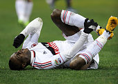 Mario Balotelli of AC Milan injured during the Serie A match between Genoa CFC and AC Milan at Stadio Luigi Ferraris on March 8 2013 in Genoa Italy