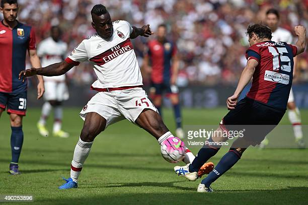 Mario Balotelli of AC Milan is challenged by Giovanni Marchese of Genoa CFC during the Serie A match between Genoa CFC and AC Milan at Stadio Luigi...
