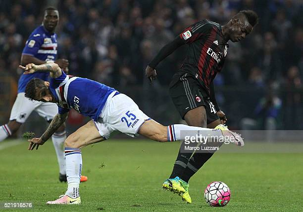 Mario Balotelli of AC Milan is challenged by Ricardo Alvarez of UC Sampdoria during the Serie A match between UC Sampdoria and AC Milan at Stadio...