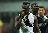Mario Balotelli of AC Milan kisses the AC Milan shirt during the Serie A match between FC Internazionale Milano and AC Milan at Stadio Giuseppe...