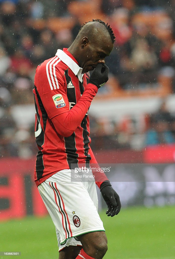 Mario Balotelli of AC Milan looks on during the Serie A match between AC Milan and US Citta di Palermo at San Siro Stadium on March 17, 2013 in Milan, Italy.