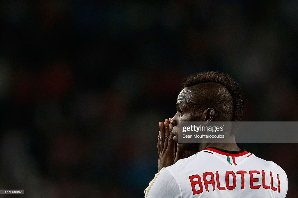 Mario Balotelli of AC Milan reacts to a missed chance during the UEFA Champions League Play-off First Leg match between PSV Eindhoven and AC Milan at PSV Stadion on August 20, 2013 in Eindhoven, Netherlands.