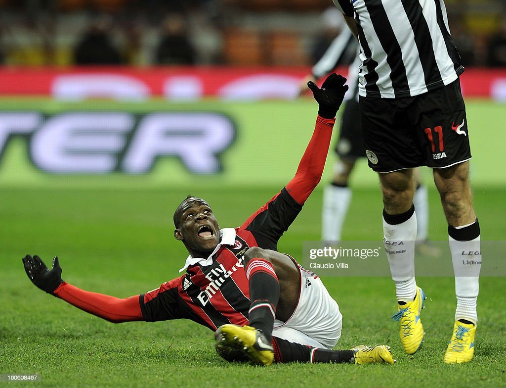 <a gi-track='captionPersonalityLinkClicked' href=/galleries/search?phrase=Mario+Balotelli&family=editorial&specificpeople=4940446 ng-click='$event.stopPropagation()'>Mario Balotelli</a> of AC Milan reacts up towards <a gi-track='captionPersonalityLinkClicked' href=/galleries/search?phrase=Maurizio+Domizzi&family=editorial&specificpeople=790985 ng-click='$event.stopPropagation()'>Maurizio Domizzi</a> of Udinese Calcio (R) during the Serie A match between AC Milan and Udinese Calcio at San Siro Stadium on February 3, 2013 in Milan, Italy.