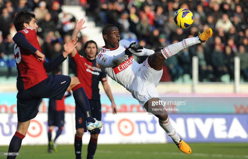 Mario Balotelli (R) of AC Milan scores a disallowed goal during the Serie A match between Cagliari Calcio and AC Milan at Stadio Is Arenas on February 10, 2013 in Cagliari, Italy.