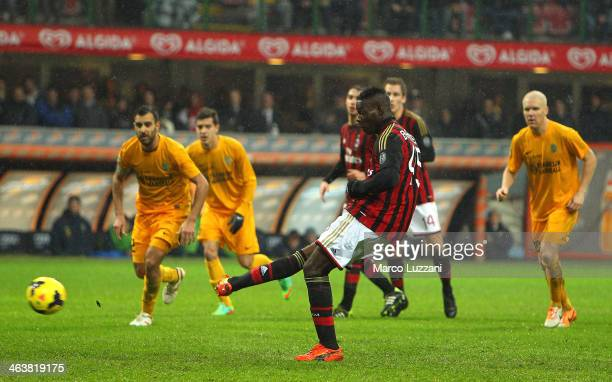 Mario Balotelli of AC Milan scores the opening from the penalty spot during the Serie A match between AC Milan and Hellas Verona FC at San Siro...
