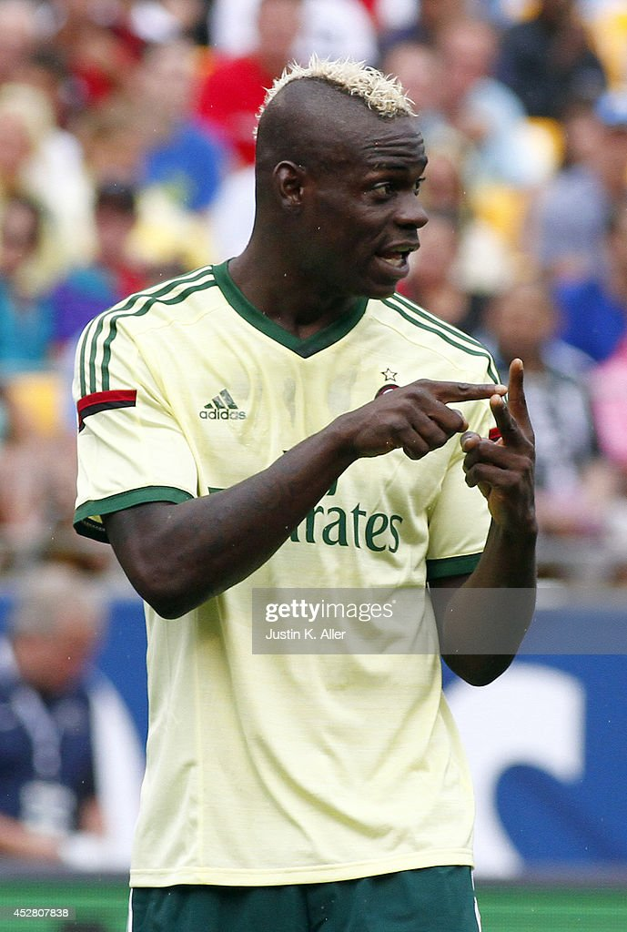 <a gi-track='captionPersonalityLinkClicked' href=/galleries/search?phrase=Mario+Balotelli&family=editorial&specificpeople=4940446 ng-click='$event.stopPropagation()'>Mario Balotelli</a> #45 of AC Milan signals to teammates against Manchester City during International Champions Cup 2014 at Heinz Field on July 27, 2014 in Pittsburgh, Pennsylvania.