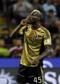 Mario Balotelli of AC Milan silences the fans of AS Rom during the Serie A match between AC Milan and AS Roma at San Siro Stadium on May 12 2013 in...