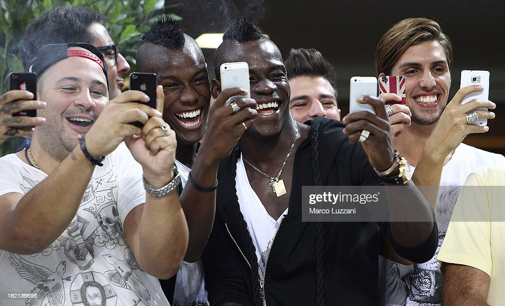 <a gi-track='captionPersonalityLinkClicked' href=/galleries/search?phrase=Mario+Balotelli&family=editorial&specificpeople=4940446 ng-click='$event.stopPropagation()'>Mario Balotelli</a> (2nd R) of AC Milan takes a photograph with his phone before the Serie A match between AC Milan and UC Sampdoria at Stadio Giuseppe Meazza on September 28, 2013 in Milan, Italy.