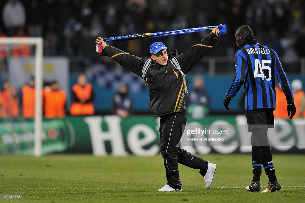 Mario Balotelli of FC Inter (R) looks at a Dynamo Kiev fan as he runs onto the pitch during a UEFA Champions League, Group F football match with FC Dynamo in Kiev on November 4, 2009. Milan won 2:1.
