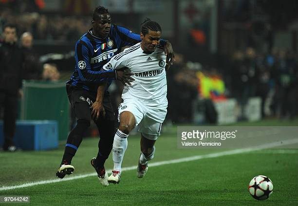 Mario Balotelli of Inter Milan competes for the ball with Florent Malouda of Chelsea during the UEFA Champions League round of 16 first leg match...