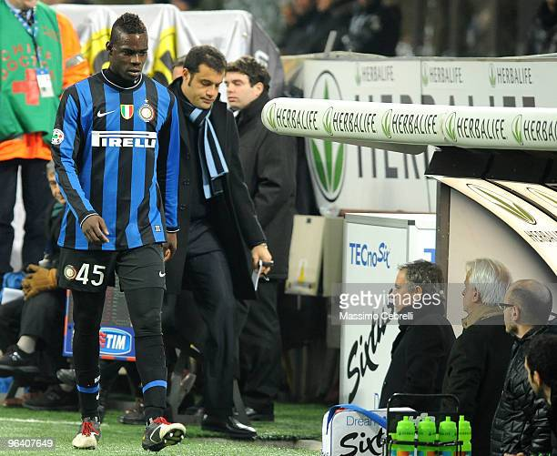 Mario Balotelli of Internazionale Milan walks passed head coach Jose Mourinho angry to be substituted during the first leg semifinal Tim Cup between...