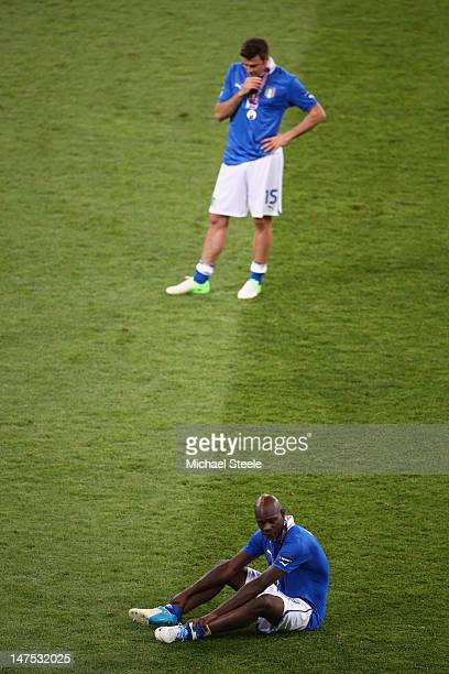 Mario Balotelli of Italy and Andrea Barzagli of Italy show their dejection after their defeat during the UEFA EURO 2012 final match between Spain and...