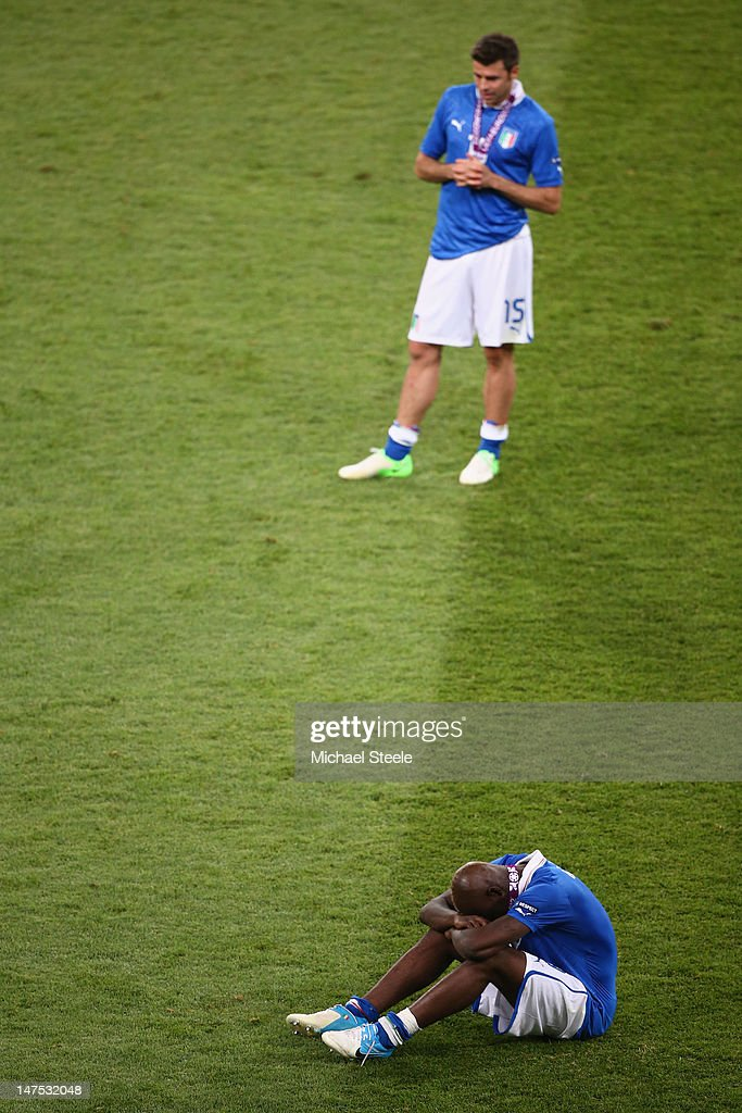 <a gi-track='captionPersonalityLinkClicked' href=/galleries/search?phrase=Mario+Balotelli&family=editorial&specificpeople=4940446 ng-click='$event.stopPropagation()'>Mario Balotelli</a> (R) of Italy and <a gi-track='captionPersonalityLinkClicked' href=/galleries/search?phrase=Andrea+Barzagli&family=editorial&specificpeople=465353 ng-click='$event.stopPropagation()'>Andrea Barzagli</a> of Italy show their dejection after their defeat during the UEFA EURO 2012 final match between Spain and Italy at the Olympic Stadium on July 1, 2012 in Kiev, Ukraine.