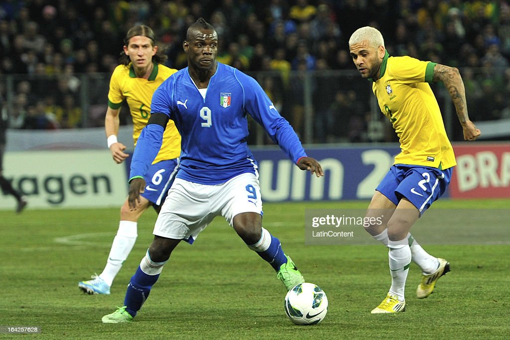 <a gi-track='captionPersonalityLinkClicked' href=/galleries/search?phrase=Mario+Balotelli&family=editorial&specificpeople=4940446 ng-click='$event.stopPropagation()'>Mario Balotelli</a> of Italy and Daniel Alves of Brazil in action during the FIFA friendly match between Brazil and Italy on March 21, 2013 in Geneva, Switzerland.