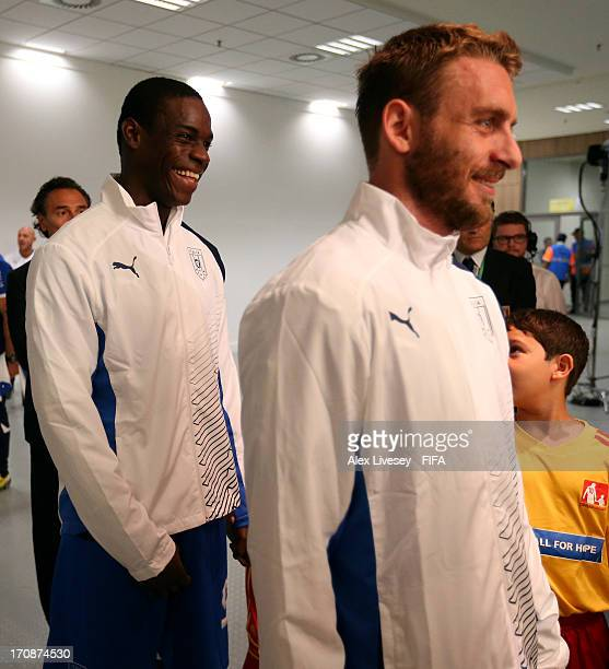 Mario Balotelli of Italy and Daniele De Rossi wait to walk out onto the pitch prior to the FIFA Confederations Cup Brazil 2013 Group A match between...