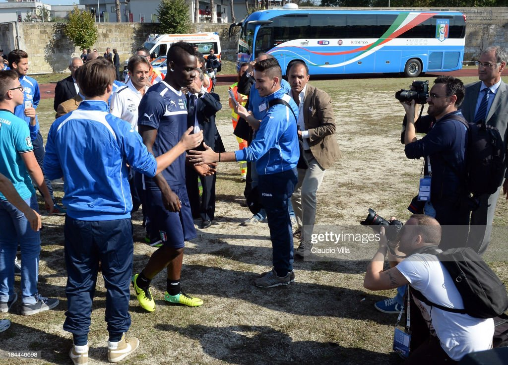 <a gi-track='captionPersonalityLinkClicked' href=/galleries/search?phrase=Mario+Balotelli&family=editorial&specificpeople=4940446 ng-click='$event.stopPropagation()'>Mario Balotelli</a> of Italy arrives before of a training session, ahead of their FIFA World Cup qualifier against Armenia, on October 14, 2013 in Naples, Italy. The training session was organised at Quarto, a football pitch built on land confiscated from the Camorra - the Neapolitan Mafia, as part of the fight against the mafia.