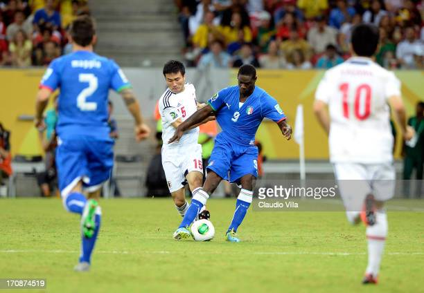Mario Balotelli of Italy battles with Yasuyuki Konno of Japan during the FIFA Confederations Cup Brazil 2013 Group A match between Italy and Japan at...