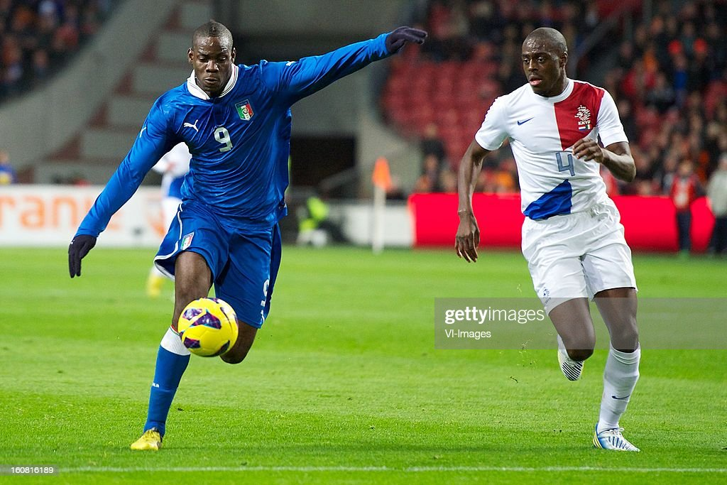 Mario Balotelli of Italy, Bruno Martins Indi of Holland during the International Friendly Match between The Netherlands and Italy at the Amsterdam Arena on february 2, 2013 in Amsterdam, The Netherlands