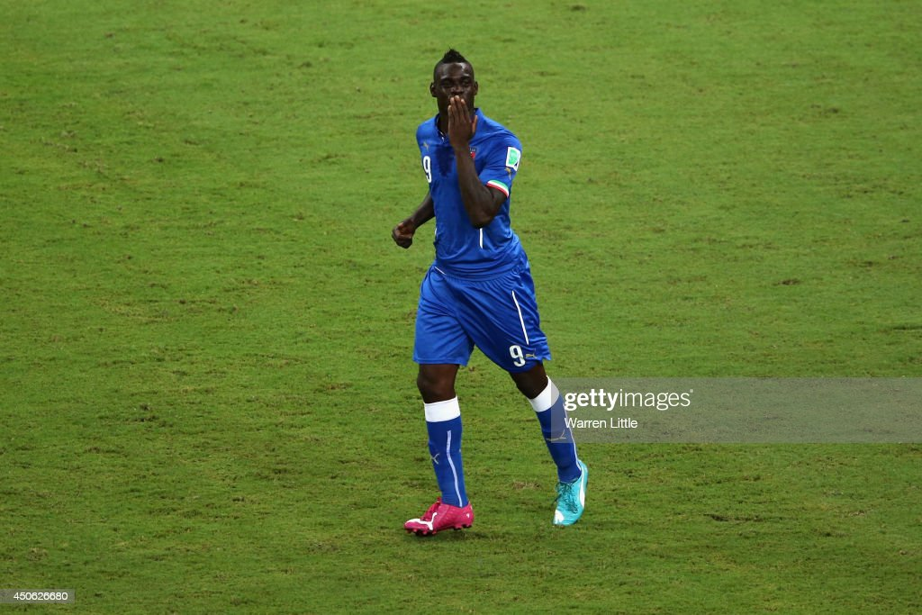 <a gi-track='captionPersonalityLinkClicked' href=/galleries/search?phrase=Mario+Balotelli&family=editorial&specificpeople=4940446 ng-click='$event.stopPropagation()'>Mario Balotelli</a> of Italy celebrates after scoring Italy's second goal during the 2014 FIFA World Cup Brazil Group D match between England and Italy at Arena Amazonia on June 14, 2014 in Manaus, Brazil.