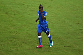 Mario Balotelli of Italy celebrates after scoring Italy's second goal during the 2014 FIFA World Cup Brazil Group D match between England and Italy...