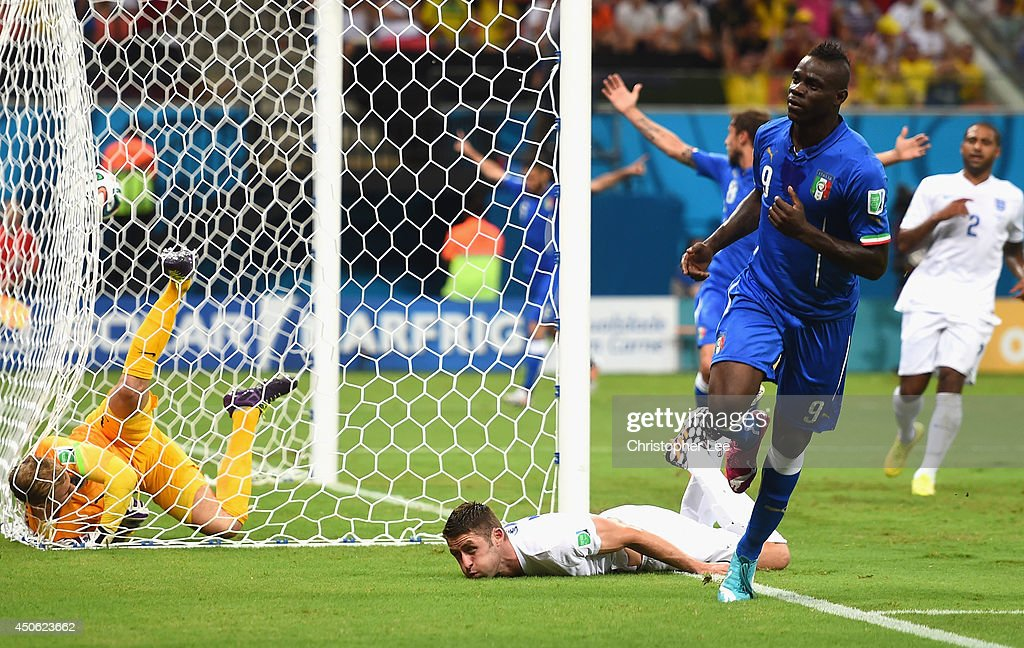 <a gi-track='captionPersonalityLinkClicked' href=/galleries/search?phrase=Mario+Balotelli&family=editorial&specificpeople=4940446 ng-click='$event.stopPropagation()'>Mario Balotelli</a> of Italy celebrates after scoring the second goal during the 2014 FIFA World Cup Brazil Group D match between England and Italy at Arena Amazonia on June 14, 2014 in Manaus, Brazil.