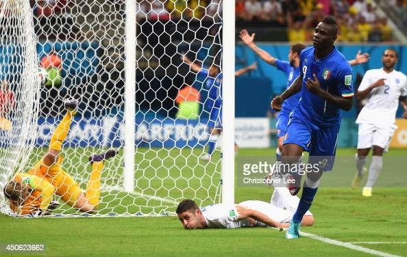 Mario Balotelli of Italy celebrates after scoring the second goal during the 2014 FIFA World Cup Brazil Group D match between England and Italy at...
