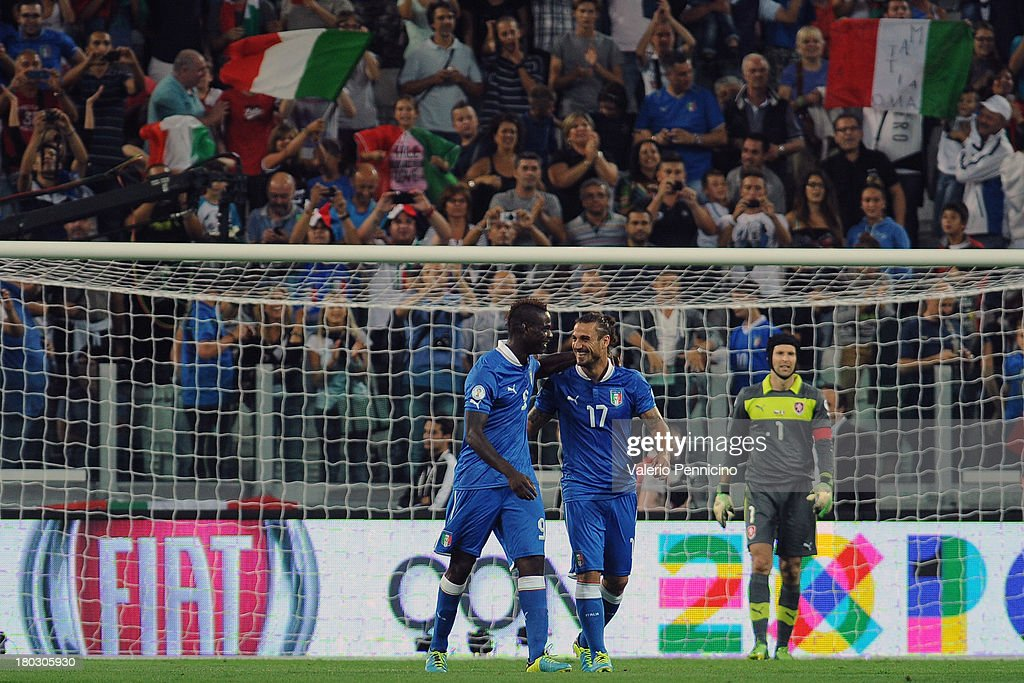 <a gi-track='captionPersonalityLinkClicked' href=/galleries/search?phrase=Mario+Balotelli&family=editorial&specificpeople=4940446 ng-click='$event.stopPropagation()'>Mario Balotelli</a> (L) of Italy celebrates his goal with team mates <a gi-track='captionPersonalityLinkClicked' href=/galleries/search?phrase=Pablo+Daniel+Osvaldo&family=editorial&specificpeople=4607628 ng-click='$event.stopPropagation()'>Pablo Daniel Osvaldo</a> during the FIFA 2014 World Cup Qualifier group B match between Italy and Czech Republic at Juventus Arena on September 10, 2013 in Turin, Italy.