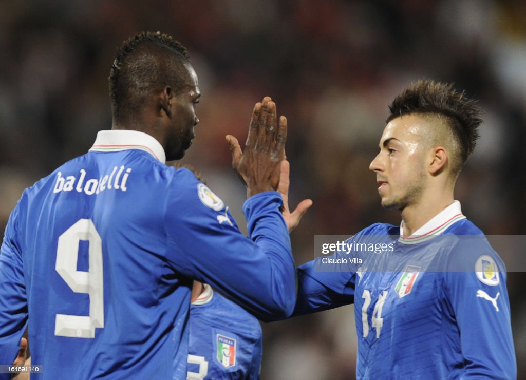 <a gi-track='captionPersonalityLinkClicked' href=/galleries/search?phrase=Mario+Balotelli&family=editorial&specificpeople=4940446 ng-click='$event.stopPropagation()'>Mario Balotelli</a> of Italy #9 celebrates scoring his team's second goal with team-mate <a gi-track='captionPersonalityLinkClicked' href=/galleries/search?phrase=Stephan+El+Shaarawy&family=editorial&specificpeople=7181554 ng-click='$event.stopPropagation()'>Stephan El Shaarawy</a> during the FIFA 2014 World Cup qualifier match between Malta and Italy at Ta Qali Stadium on March 26, 2013 in Malta, Malta.
