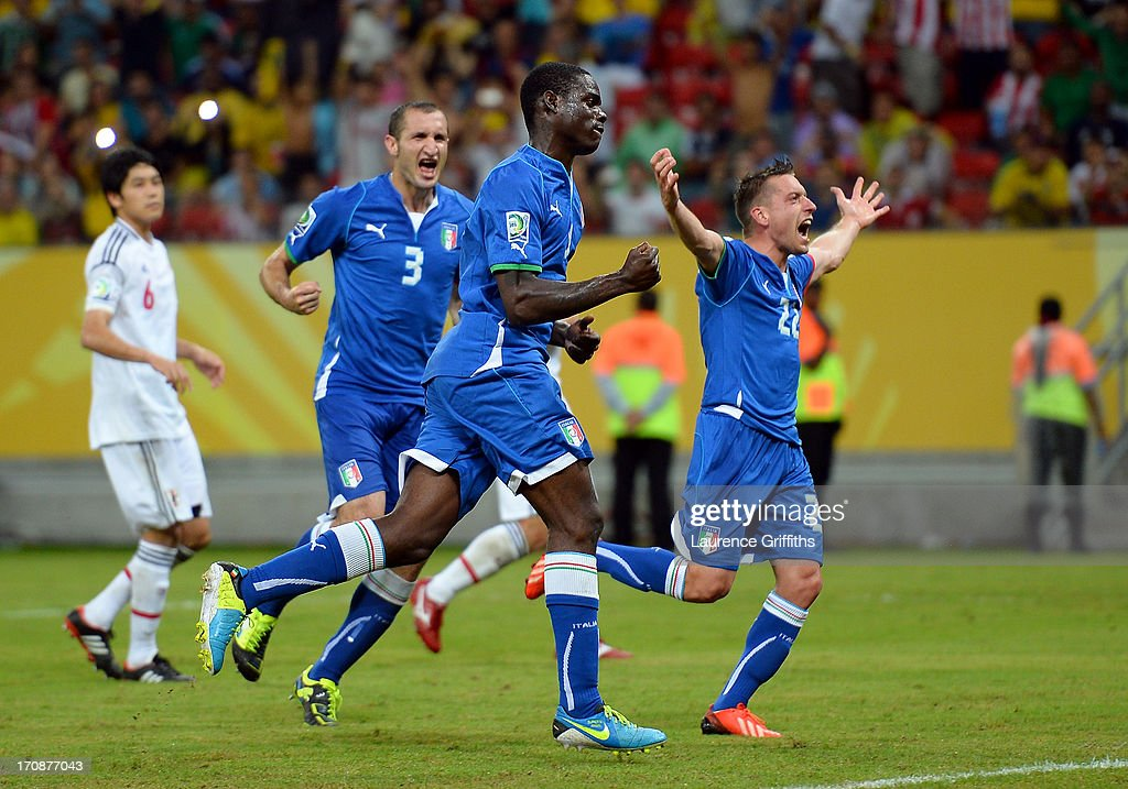 <a gi-track='captionPersonalityLinkClicked' href=/galleries/search?phrase=Mario+Balotelli&family=editorial&specificpeople=4940446 ng-click='$event.stopPropagation()'>Mario Balotelli</a> of Italy celebrates scoring his team's third goal with <a gi-track='captionPersonalityLinkClicked' href=/galleries/search?phrase=Emanuele+Giaccherini&family=editorial&specificpeople=6675873 ng-click='$event.stopPropagation()'>Emanuele Giaccherini</a> (r) during the FIFA Confederations Cup Brazil 2013 Group A match between Italy and Japan at Arena Pernambuco on June 19, 2013 in Recife, Brazil.
