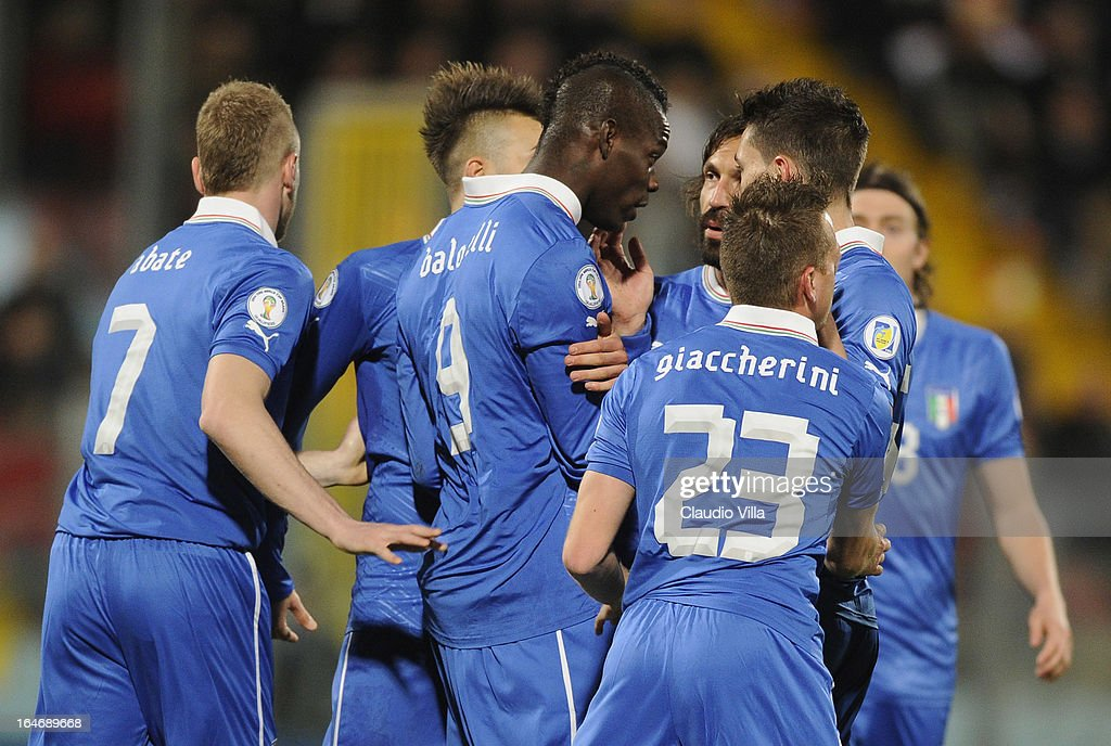 Mario Balotelli (C) of Italy celebrates scoring the first goal during the FIFA 2014 World Cup qualifier match between Malta and Italy at Ta Qali Stadium on March 26, 2013 in Malta, Malta.