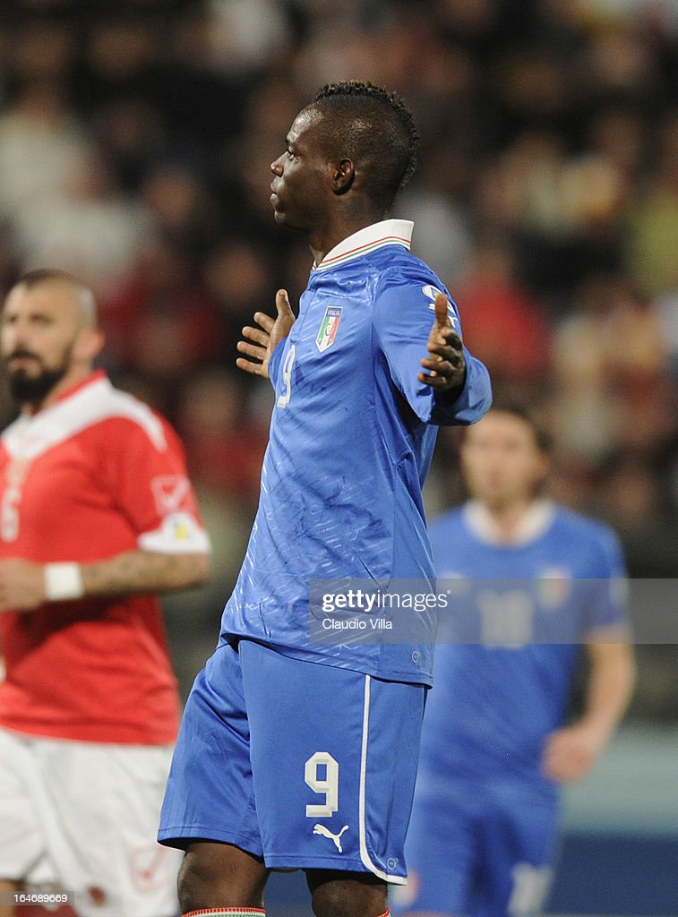 <a gi-track='captionPersonalityLinkClicked' href=/galleries/search?phrase=Mario+Balotelli&family=editorial&specificpeople=4940446 ng-click='$event.stopPropagation()'>Mario Balotelli</a> (C) of Italy celebrates scoring the first goal during the FIFA 2014 World Cup qualifier match between Malta and Italy at Ta Qali Stadium on March 26, 2013 in Malta, Malta.