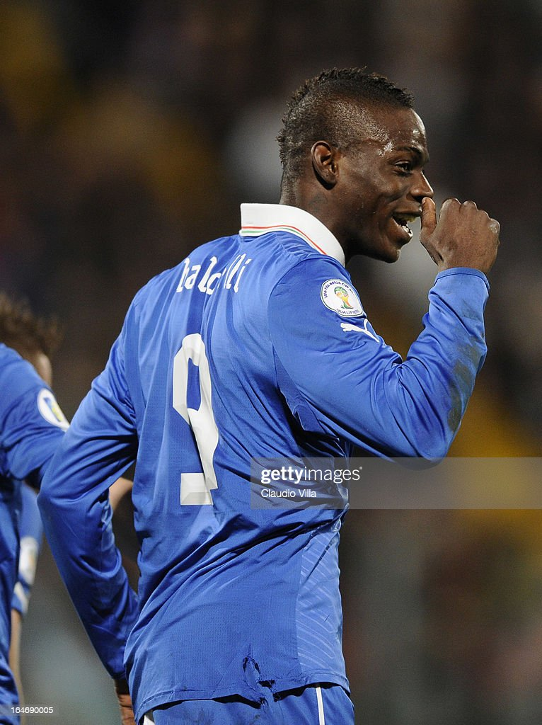 <a gi-track='captionPersonalityLinkClicked' href=/galleries/search?phrase=Mario+Balotelli&family=editorial&specificpeople=4940446 ng-click='$event.stopPropagation()'>Mario Balotelli</a> of Italy #9 celebrates scoring the second goal during the FIFA 2014 World Cup qualifier match between Malta and Italy at Ta Qali Stadium on March 26, 2013 in Malta, Malta.