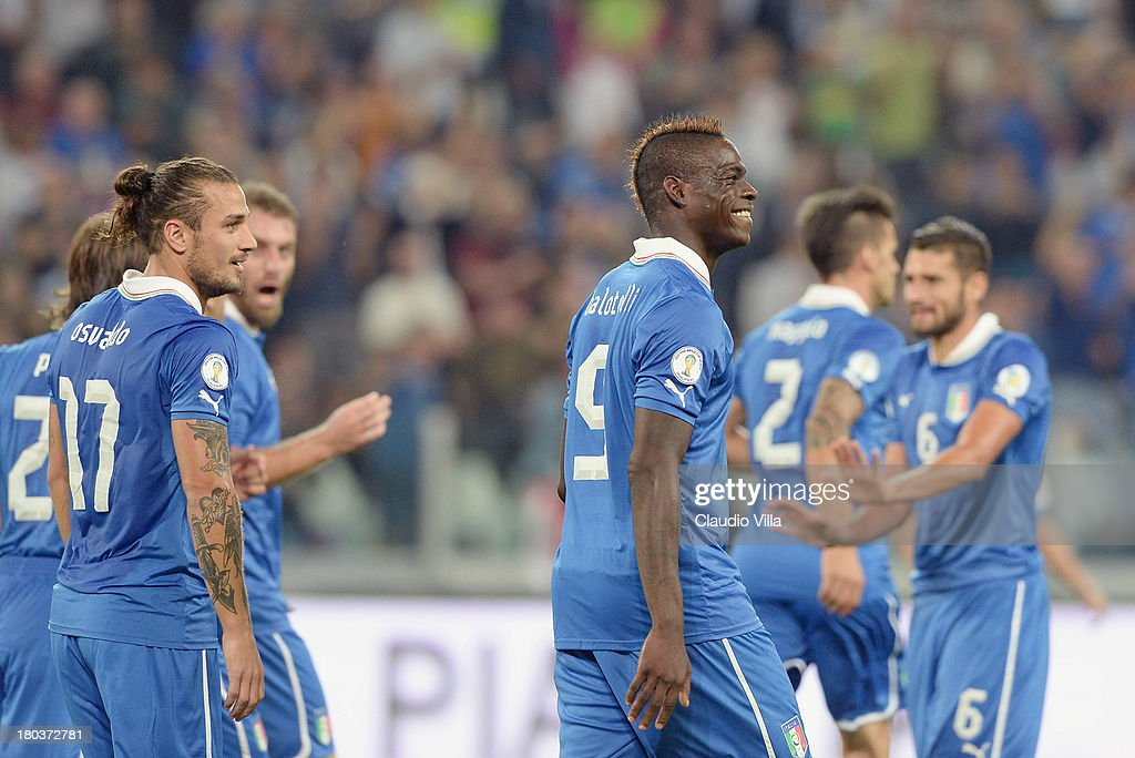 <a gi-track='captionPersonalityLinkClicked' href=/galleries/search?phrase=Mario+Balotelli&family=editorial&specificpeople=4940446 ng-click='$event.stopPropagation()'>Mario Balotelli</a> of Italy #9 celebrates scoring the second goal during the FIFA 2014 World Cup Qualifier group B match between Italy and Bulgaria at Juventus Arena on September 10, 2013 in Turin, Italy.