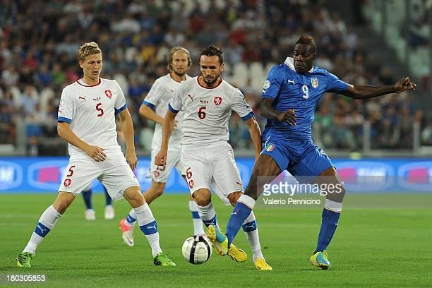 Mario Balotelli of Italy competes with Tomas Sivok of Czech Republic during the FIFA 2014 World Cup Qualifier group B match between Italy and Czech...