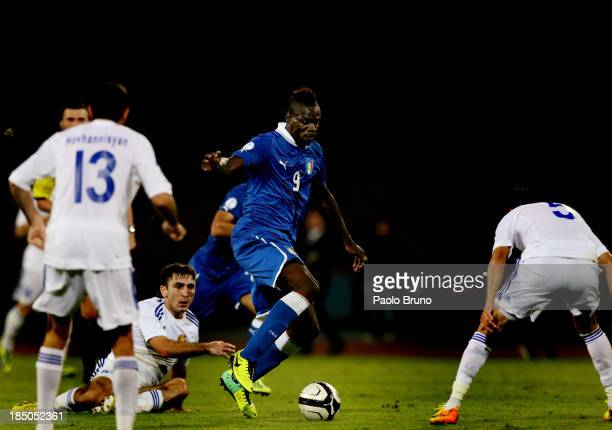 Mario Balotelli of Italy fights for the ball against Armenia players during the FIFA 2014 World Cup qualifier group B match between Italy and Armenia...