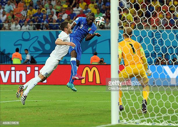 Mario Balotelli of Italy heads his side's second goal during the 2014 FIFA World Cup Brazil Group D match between England and Italy at Arena Amazonia...