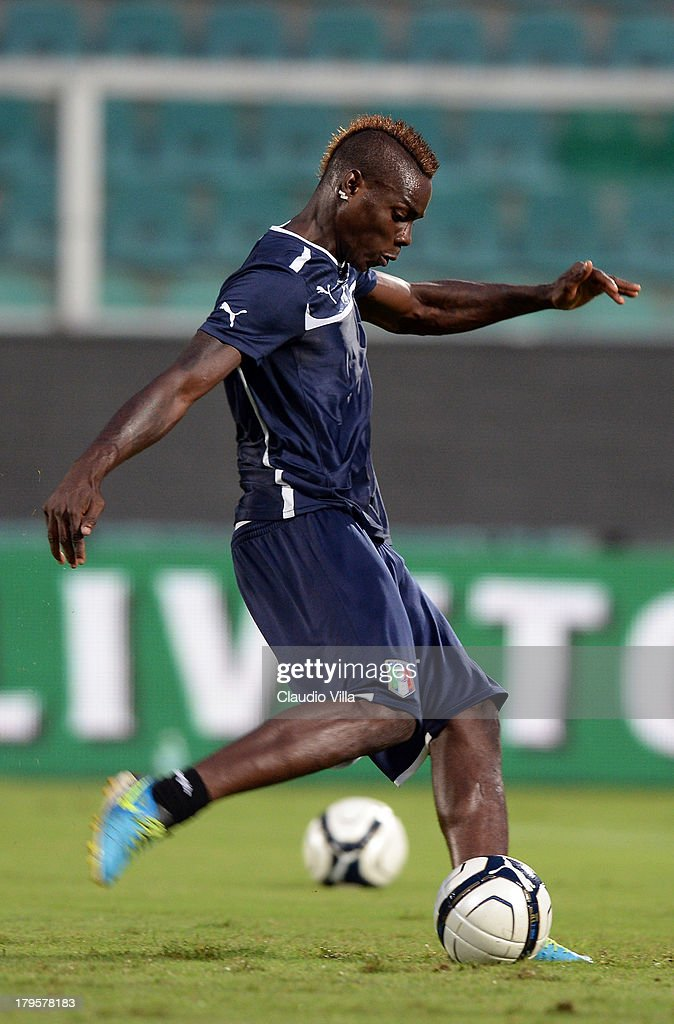 <a gi-track='captionPersonalityLinkClicked' href=/galleries/search?phrase=Mario+Balotelli&family=editorial&specificpeople=4940446 ng-click='$event.stopPropagation()'>Mario Balotelli</a> of Italy in action during a training session at Stadio Renzo Barbera on September 5, 2013 in Palermo, Italy.