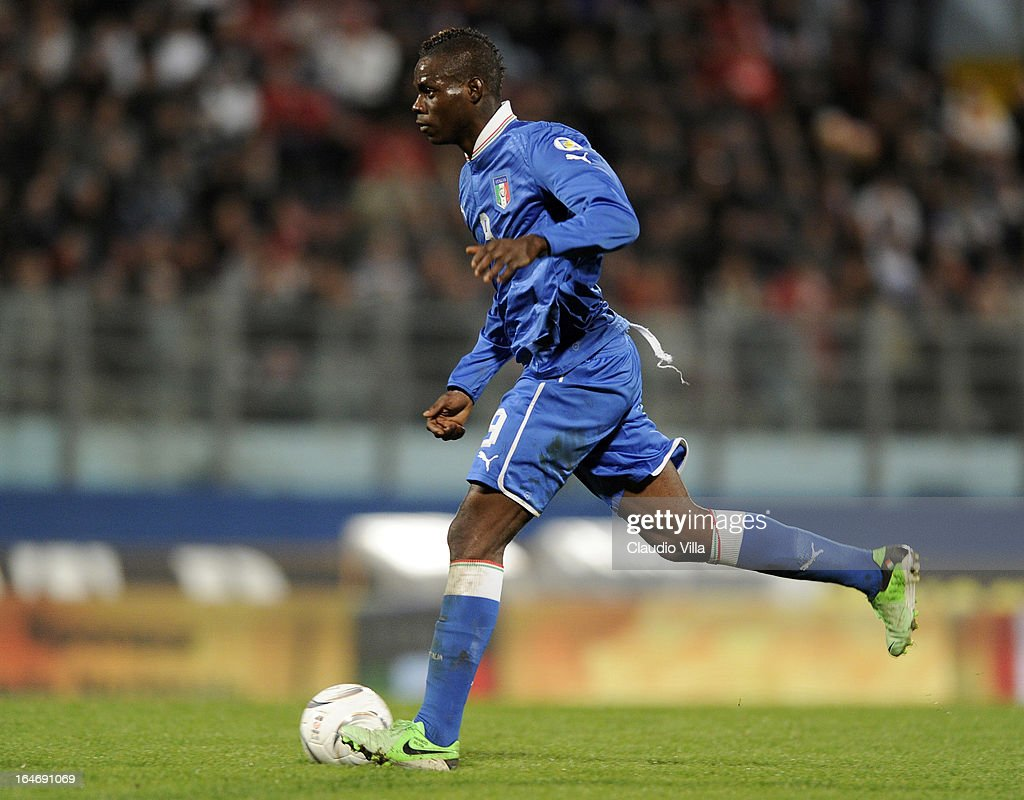 <a gi-track='captionPersonalityLinkClicked' href=/galleries/search?phrase=Mario+Balotelli&family=editorial&specificpeople=4940446 ng-click='$event.stopPropagation()'>Mario Balotelli</a> of Italy in action during the FIFA 2014 World Cup qualifier match between Malta and Italy at Ta Qali Stadium on March 26, 2013 in Malta, Malta.