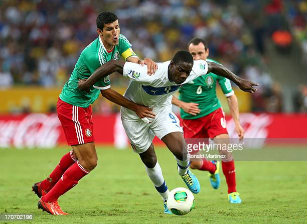 Mario Balotelli of Italy is challenged by Francisco Javier Rodriguez of Mexico during the FIFA Confederations Cup Brazil 2013 Group A match between...