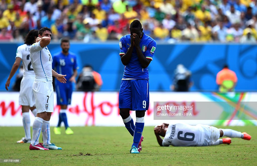 Mario Balotelli of Italy reacts after colliding with Alvaro Pereira of Uruguay during the 2014 FIFA World Cup Brazil Group D match between Italy and Uruguay at Estadio das Dunas on June 24, 2014 in Natal, Brazil.