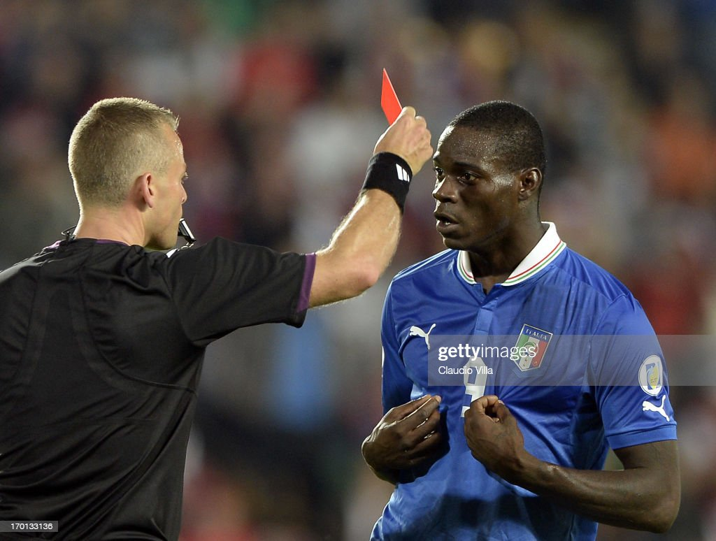 <a gi-track='captionPersonalityLinkClicked' href=/galleries/search?phrase=Mario+Balotelli&family=editorial&specificpeople=4940446 ng-click='$event.stopPropagation()'>Mario Balotelli</a> of Italy reacts as he is shown a red card by referee Svein Oddvar Moen shows the red card to during the FIFA 2014 World Cup Qualifier group B match between Czech Republic and Italy at Generali Arena on June 7, 2013 in Prague, Czech Republic.
