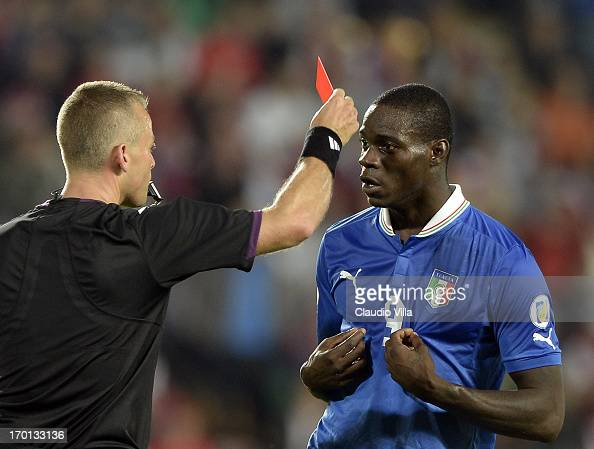 Mario Balotelli of Italy reacts as he is shown a red card by referee Svein Oddvar Moen shows the red card to during the FIFA 2014 World Cup Qualifier...