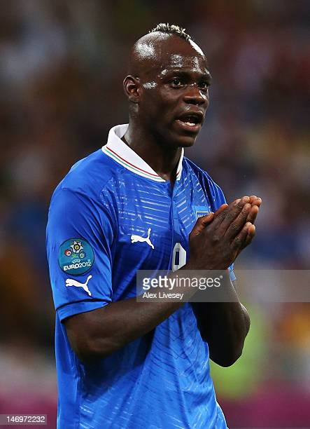 Mario Balotelli of Italy reacts during the UEFA EURO 2012 quarter final match between England and Italy at The Olympic Stadium on June 24 2012 in...