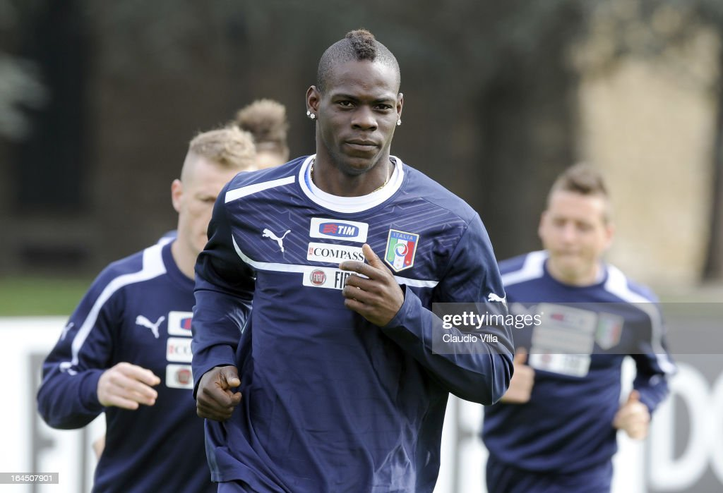 <a gi-track='captionPersonalityLinkClicked' href=/galleries/search?phrase=Mario+Balotelli&family=editorial&specificpeople=4940446 ng-click='$event.stopPropagation()'>Mario Balotelli</a> of Italy runs during a training Session at Coverciano on March 24, 2013 in Florence, Italy.