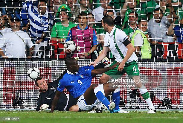 Mario Balotelli of Italy scores his side's second goal past Shay Given of Republic of Ireland during the UEFA EURO 2012 group C match between Italy...