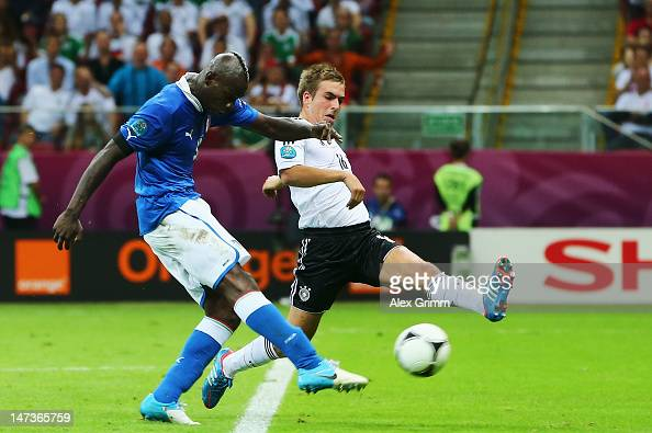 Mario Balotelli of Italy scores his team's second goal past Philipp Lahm of Germany during the UEFA EURO 2012 semi final match between Germany and...