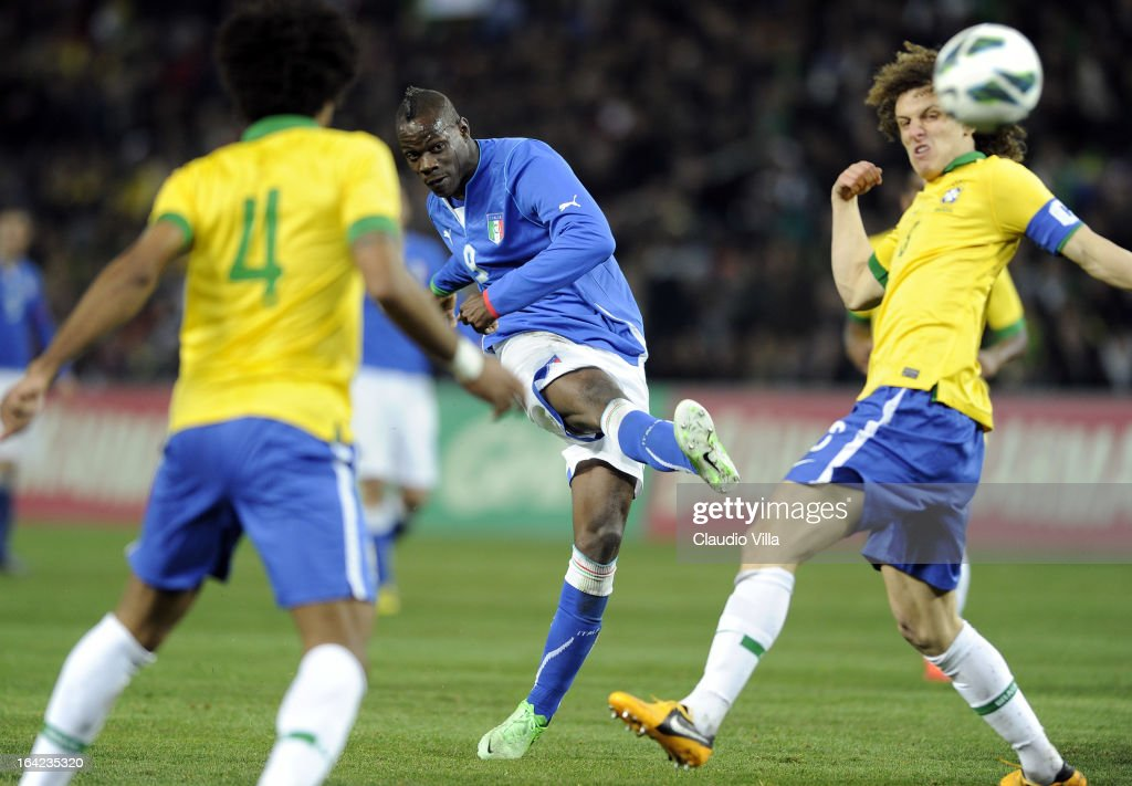 <a gi-track='captionPersonalityLinkClicked' href=/galleries/search?phrase=Mario+Balotelli&family=editorial&specificpeople=4940446 ng-click='$event.stopPropagation()'>Mario Balotelli</a> of Italy scores their second goal during the international friendly match between Italy and Brazil on March 21, 2013 in Geneva, Switzerland.