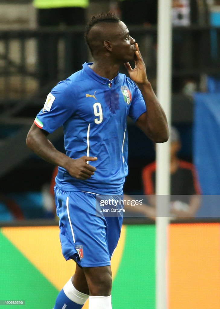 Mario Balotelli of Italy sends kisses to his fiancee Fanny Neguesha in the stands after scoring the winning goal during the 2014 FIFA World Cup Brazil Group D match between England and Italy at Arena Amazonia on June 14, 2014 in Manaus, Brazil.